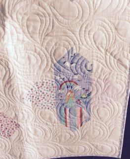 For a young person or young at heart. This quilt features unicorns and princesses, castles and frogs! Background is a soft pink slightly patterned print.