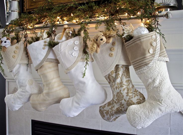 Such a brilliant idea...two stocking holders and a curtain rod to hold at least five stockings!  Source: 2013 Christmas Stocking Round-Up | South House Designs