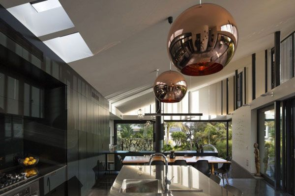 These contrasting metallic sphere light fittings add balance to this angular space. metallic spherical lights work with Contemporary, Minimalist, 70s Retro and Industrial styles. White spherical light fittings can be more adaptable for styles such as Modern Classic, Resort style and Art Deco.
