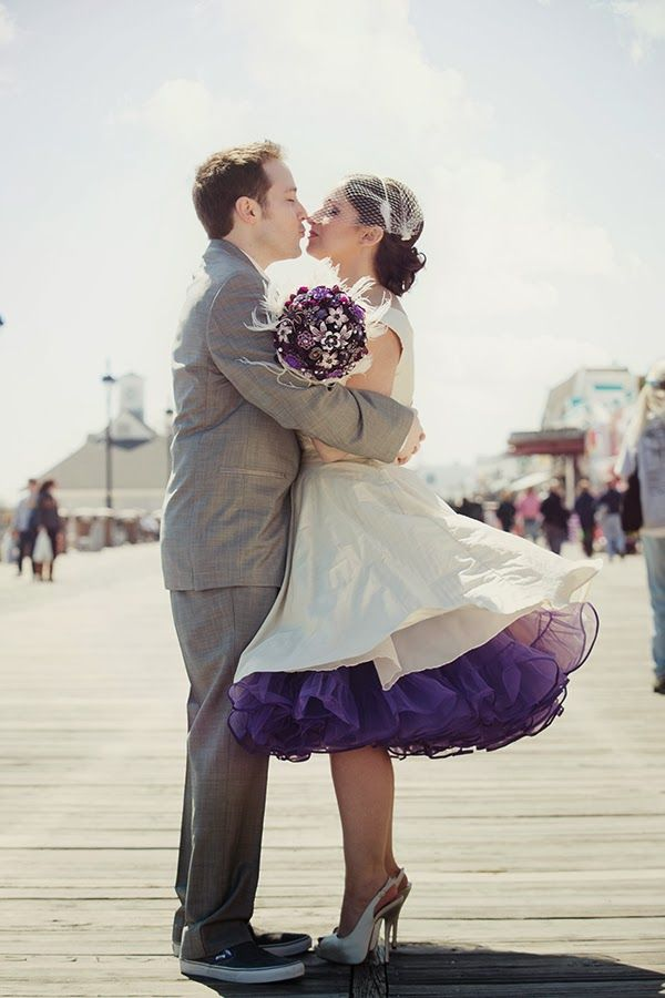 Love the colorful purple petticoat on this bridal gown!  She's also rocking the short wedding gown that's hot right now!