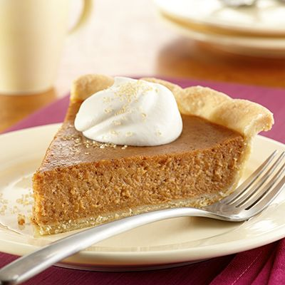 Homemade Sweet Potato Pie - Homemade sweet potato pie is real Southern comfort food. Fresh sweet potatoes, cinnamon and ginger are the secrets to this delicious pie recipe.