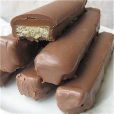 homemade twix! Totally making these...as a large pan though, don't want to dip each piece. Ain't nobody got time for that...