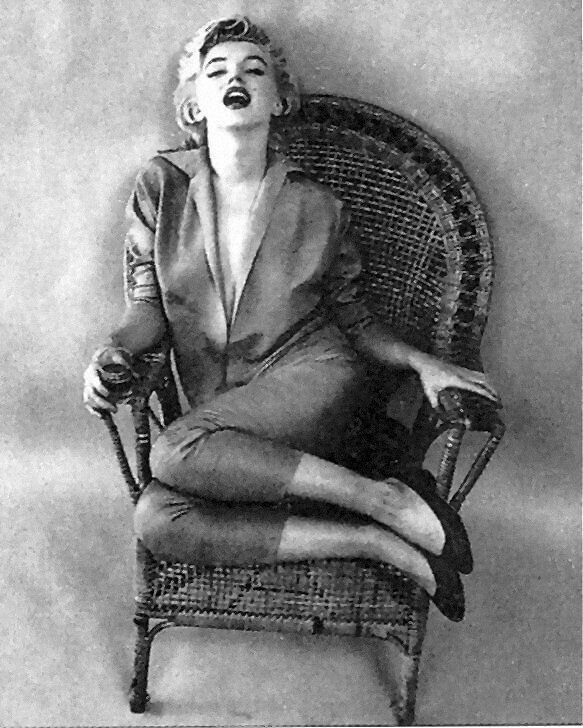Marilyn. Wickerchair sitting. Photo by Milton Greene, 1954.
