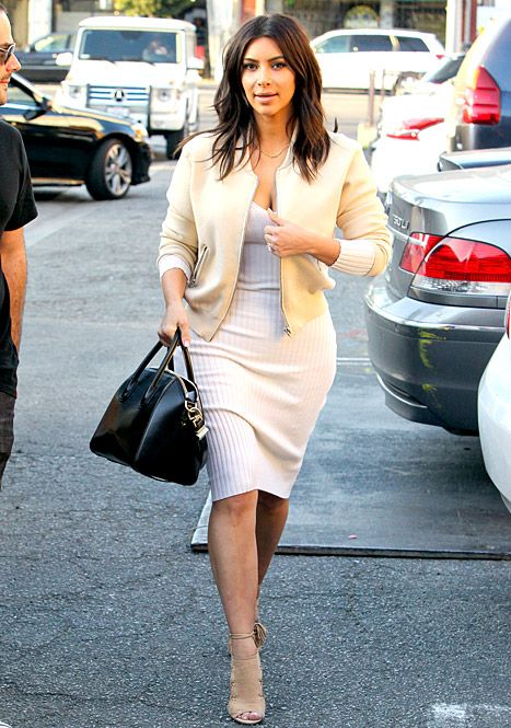 Kim Kardashian showed off her hourglass figure in a clingy white dress on March 15.
