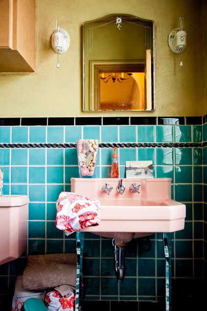 Cool way to embrace the retro vibe of an existing bathroom. I feel like every time we house hunt there's a pink bathroom somewhere in the mix!