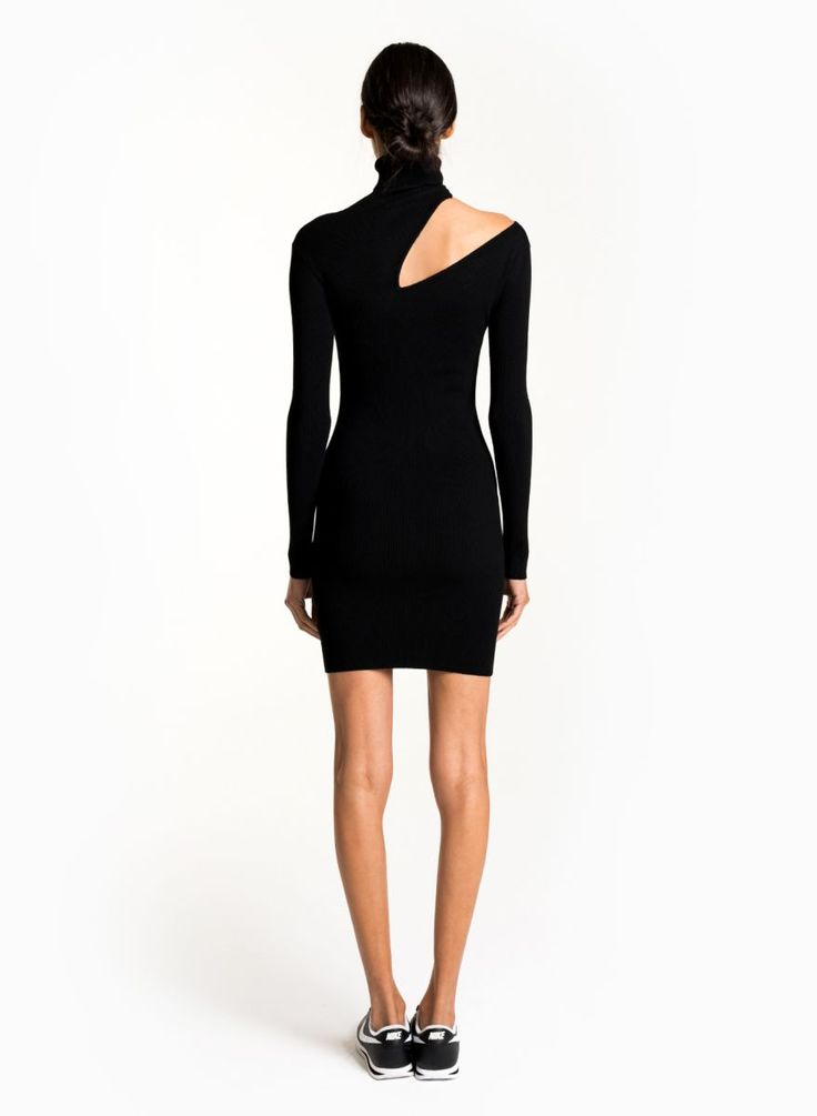 A confident ribbed knit dress that's great for layering or wearing on its own. This turtleneck style features a body-hugging fit and a cut out along the right shoulder that dips down at the chest and back. Long sleeve and pullover