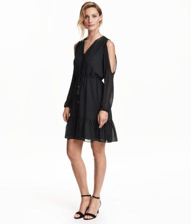 Knee-length dress in chiffon with lace details.  V-neck, long sleeves with cut-out section at shoulders, and elasticized cuffs. Elasticized seam at waist, drawstring at waist with tassels and metal decorations at ends, and flounce at hem. Lined.