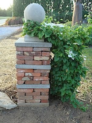 column using used bricks and inexpensive pavers with finial.