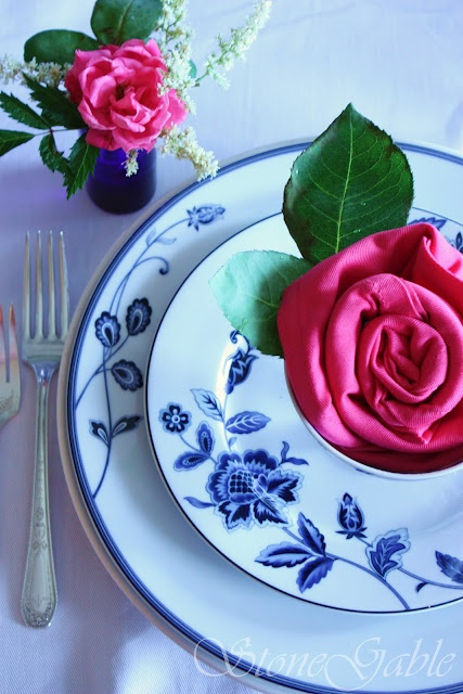 A pretty teacup and a beautiful rose folded cloth napkin. Here is the tutorial.