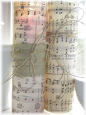 sheet music candles! Live this! http://musingsfromafrenchcottage.blogspot.com/2010/07/fun-with-sheet-music.html