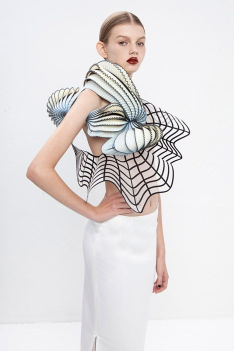 """Garments influenced by distorted digital drawings featuring 3D-printed elements."""