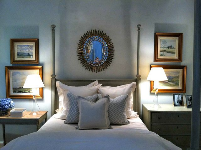 Mrs Howard store vignette - the placement of the decorative mirror balances the art on either side of the bed.