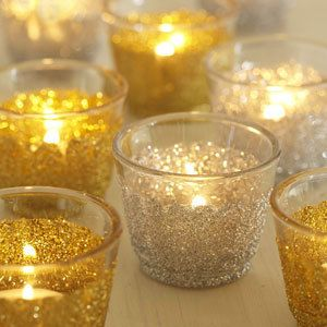 Add some sparkle to plain candle holders. You will need • Glue spatula or paintbrush • Clear-drying all-purpose glue • Glass tea-light holders • Glitter To make Use a glue spatula or paintbrush to apply glue around base of a glass tea-light holder. Place it upside down in a plastic box to catch excess, and sprinkle glitter liberally all over glued areas. Once dry, turn right way up and place a tea light inside.