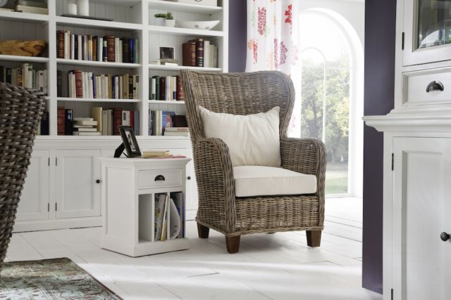 Taking woven rattan chairs to a new level, the king chair boasts a majestic wingback form. The high back wraps round to cosset sitters while the arms are kept high and throne-like. In terms of comfort, we've made a feather-filled back pillow that complements the bouncier, firmer base. This is the ideal seat for whiling away the hours.
