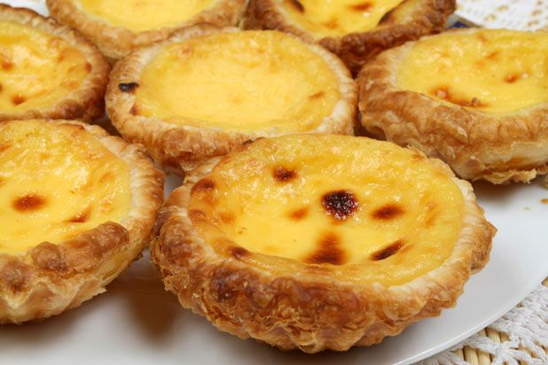 55 European Foods Worth Traveling For - via The Daily Meal | Portugal: Bacalhau com Natas + Pastel de Nata | One of the most popular sweet dishes among Portuguese citizens, pastel de nata is eggy, creamy, and rich. Credit: thinkstock