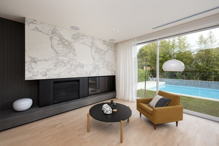 A Calacatta feature wall looks amazing in this family room. Built by Paul Jones. Photo by @rachellewisphotography  #cdkstone #calacatta #calacattamarble #marble #featurewall #naturalstone #naturalbeauty #naturesmasterpiece #designinspiration
