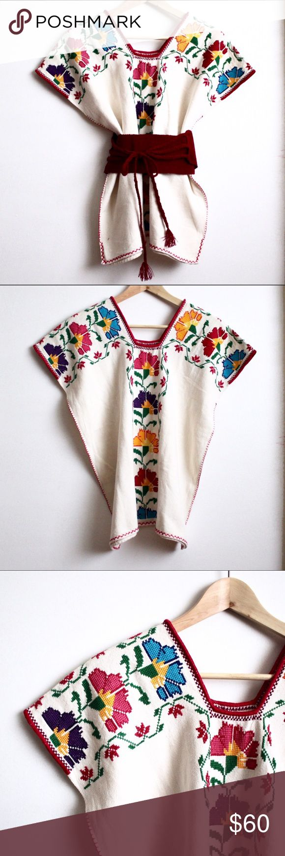 "Cross Stitch Mexican Blouse This listing includes a beautifully embroidered blouse that was handmade in Mexico. It has a very boxy fit, so I'm also including a dark pink/ red belt. This type is belt is often worn with this type of blouse. It is made of a natural cotton/linen material. The bust measures about 22"", and the length measures about 25"". No size listed. Purchased in Mexico. Free People Tops Blouses"