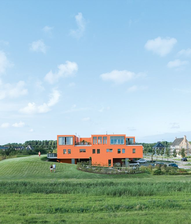 Seen here from the south, Villa van Vijven's orange facade is meant to mimic the tiled rooftops of Holland's country buildings, while the...