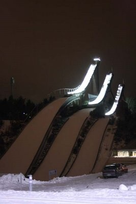 Ski jumping towers at night.