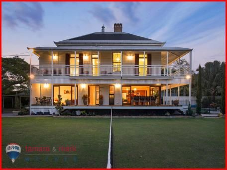 Beautiful example of a Queensland Colonial - double storey with pyramid roof, acroteria, brick chimney, large verandahs, elevated on timber stumps - Sandgate Qld