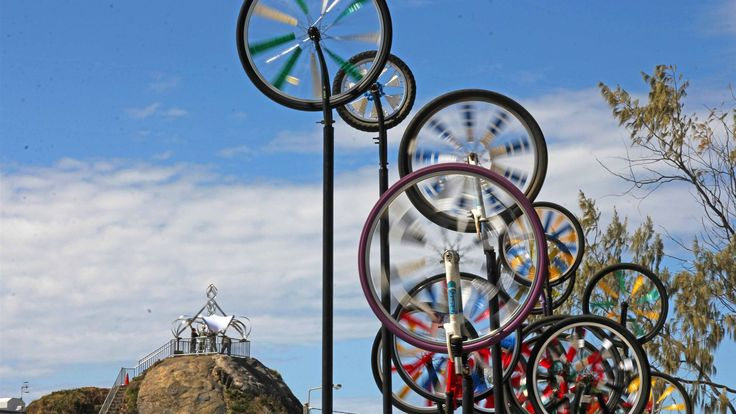 A collection of bicycle wheels spins like pinwheels in the wind as part of the Swell Sculpture Festival on the Gold Coast. (Photo: ABC/Damien Larkins.)