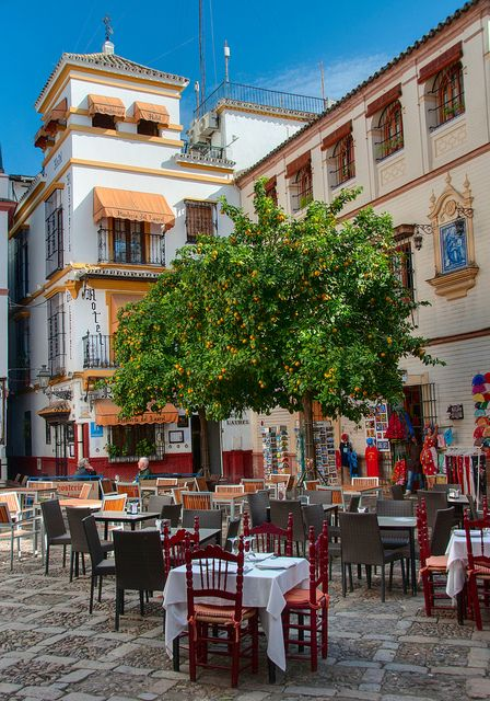Outdoor restaurant in Sevilla, Spain (This is the city my son Joshua was born in in 1981. Beautiful place! Every restaurant had out door accommodations' to enjoy your meal and take in the sights.