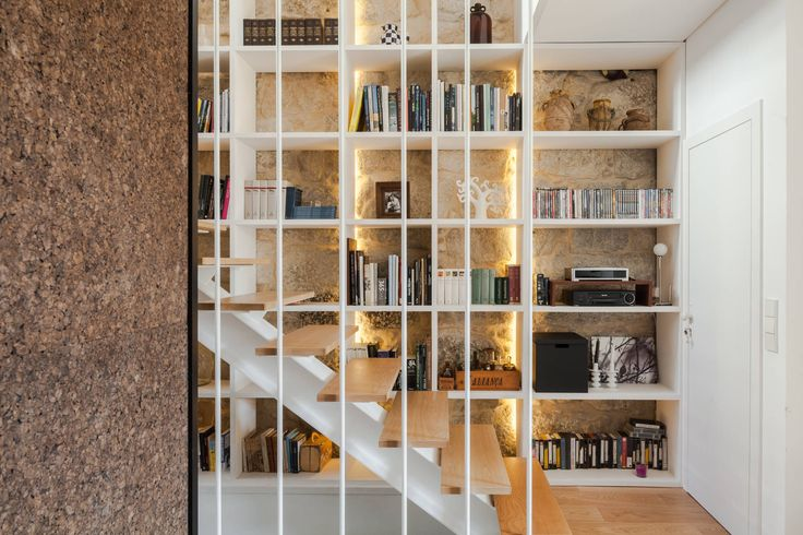 A beautiful modern storage solution at the stairs by Floret Arquitectura