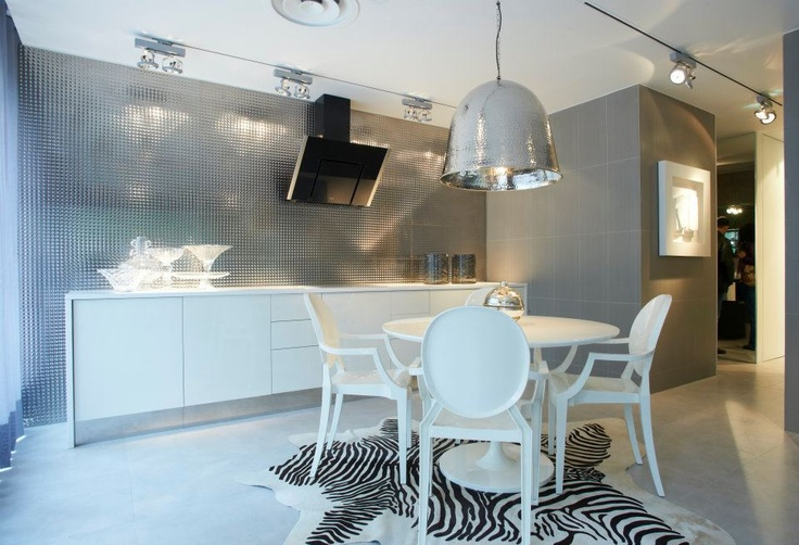 Lovetiles Showroom Lisbon, white round table, zebra rug, white chairs, silver ceiling lamp
