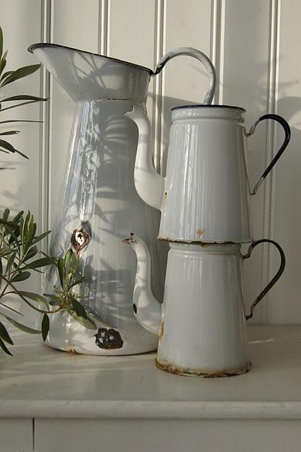 white enamel pitchers. ****