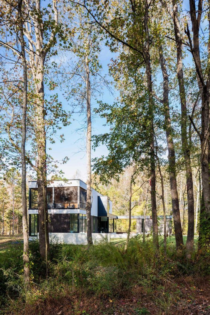 House in the woods overlooking a woodland pond - CAANdesign | Architecture and home design blog