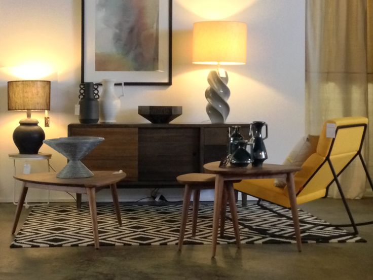 Sharp and warm: Black, white and yellow, softened with hazelnut and teak timbers.