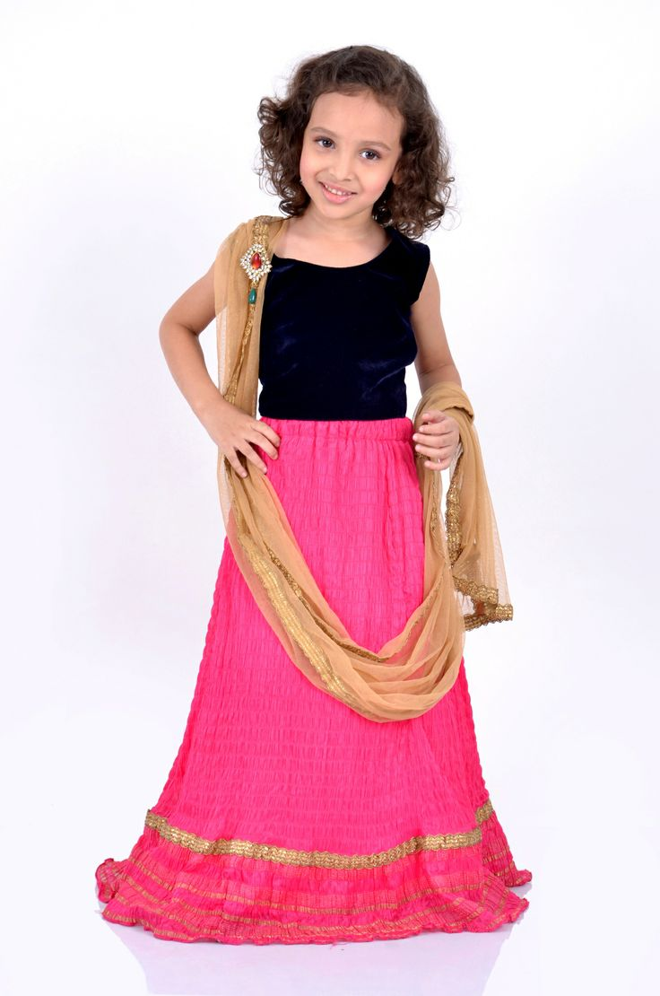 Pink & Blue Lehenga  Style Note : Make your child a star in this lehenga saree with a crushed pink lehenga and an attached gold dupatta bordered with a gold lace…the blue velvet choli adds glamour to the whole outfit enhanced with a metal kundan broach..  www.kandukids.com