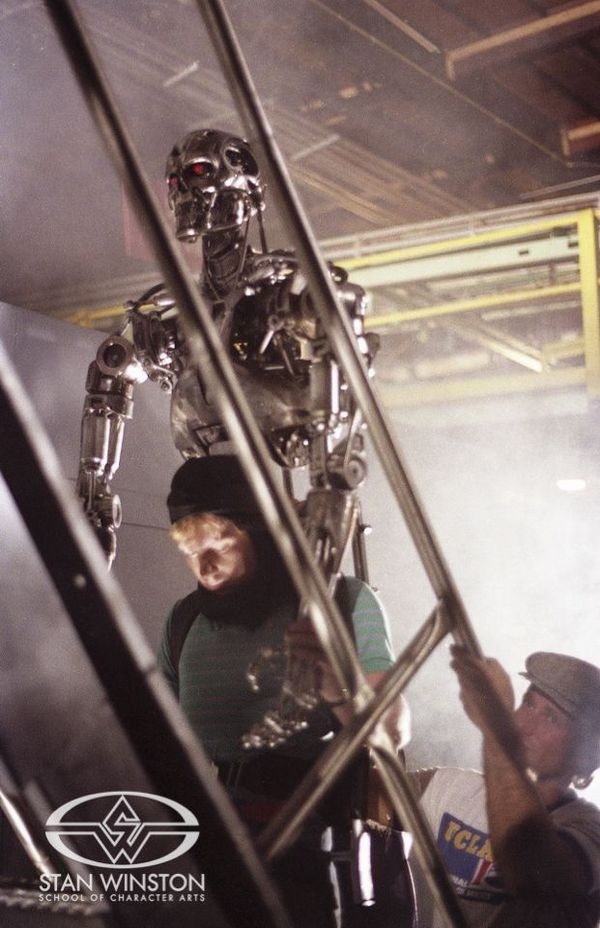Character Creator & Monster Suit performer Shane Mahan and John Rosengrant puppeteer the cyborg assassin puppet during the factory finale of THE TERMINATOR.