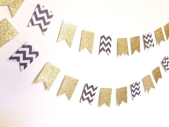 This cute and trendy paper garland is made from sturdy gold glitter cardstock and double-sided black and white chevron craft paper. The