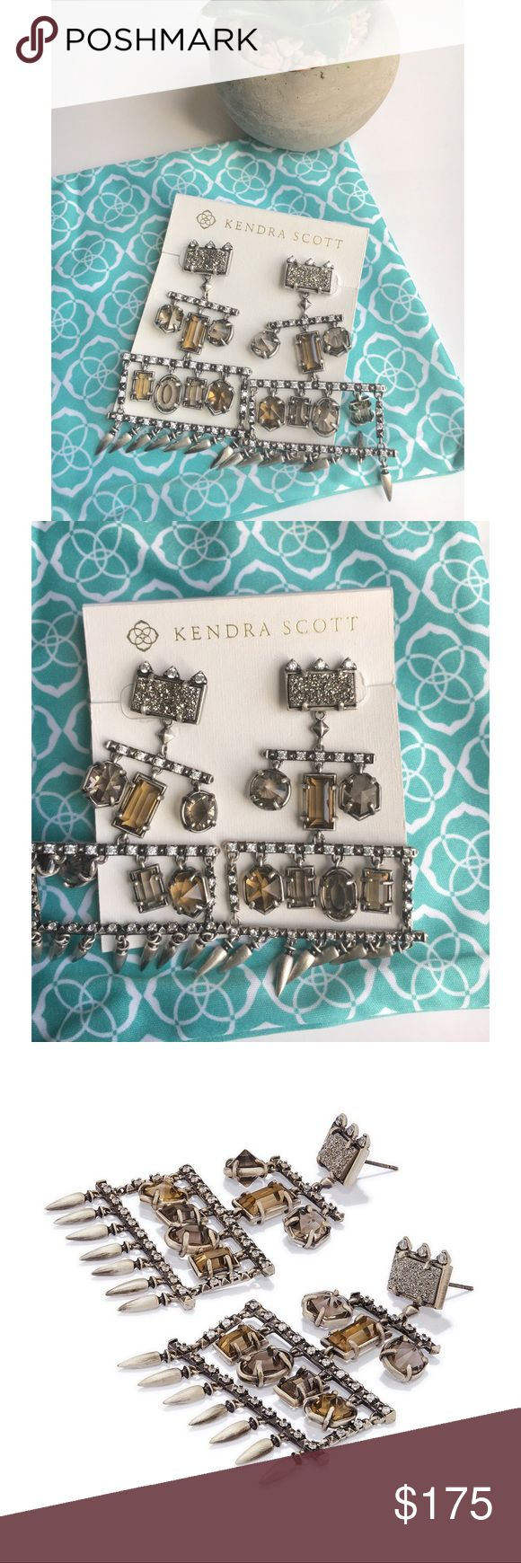 "Kendra Scott Emmylou Statement Earrings With the Emmylou Statement Earrings in Antique Silver, sparkling stones dangle in a variety of shapes to create a chandelier silhouette certain to turn heads.  • Antique Silver Plated Over Brass • Size: 2.6""L x 1.73""W on post • Material: dark smoky translucent glass, smoky translucent glass, platinum drusy  ✨Please note: Due to the one-of-a-kind nature of the medium, exact color patterns may vary slightly from the image shown. Kendra Scott Jewelry…"