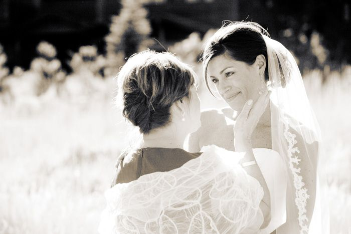Kelly and her mom sharing a very intimate moment during family formals at her Squaw Valley Lake Tahoe Wedding