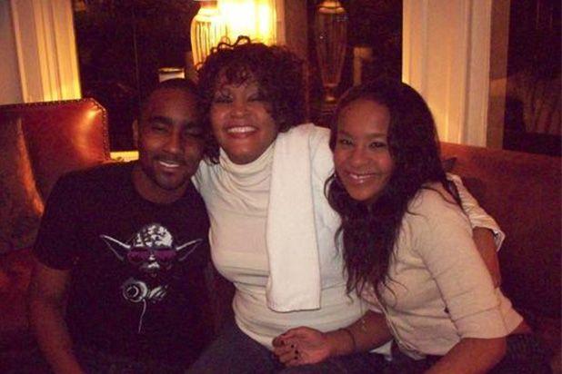 Nick Gordon, Whitney Houston, Bobbi Kristina Brown are shown in a family photo posted on Gordon's Twitter feed on Jul 19, 2014