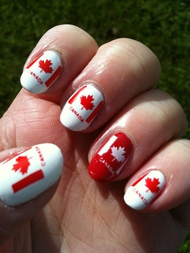 This intricate manicure clearly shows Canadian pride!