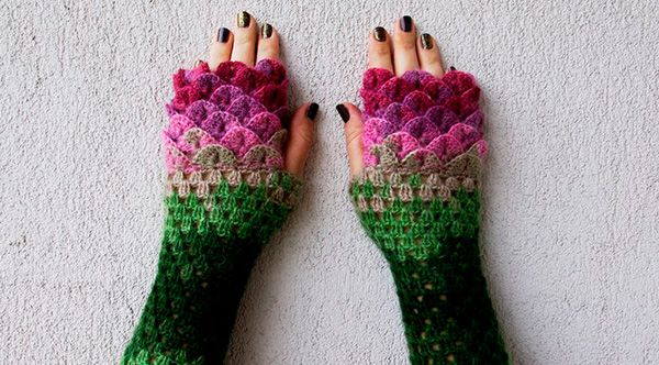 With lots of beautiful colors, crochet dragon scales, and a crocodile stitch pattern, these fingerless gloves are absolutely stunning.