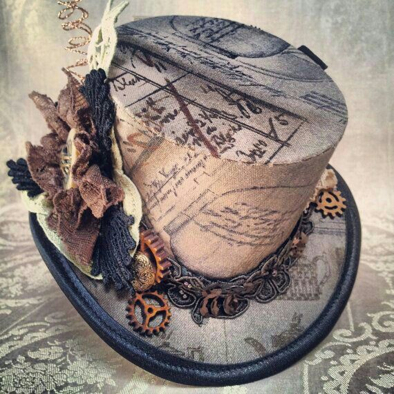 """""""old"""" steampunk hat with vintage-looking writings and gears. I want it!"""