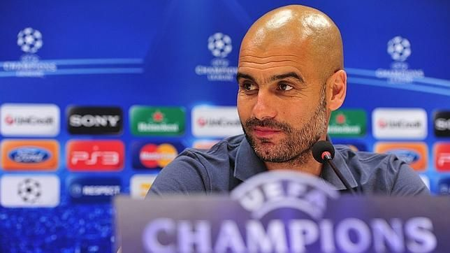 Pep Guardiola holds press comference ahead of FC Barcelona - AC Milan Champions League match.