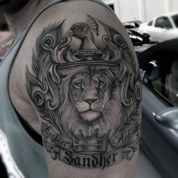 Mens Lion And Crown Family Crest Tattoo Design On Upper Arm