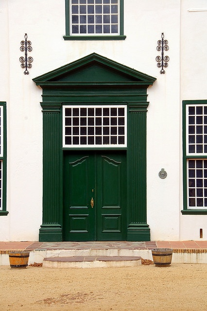 The stately striking door to the Groot Constantia Vineyard building, Cape Town, South Africa