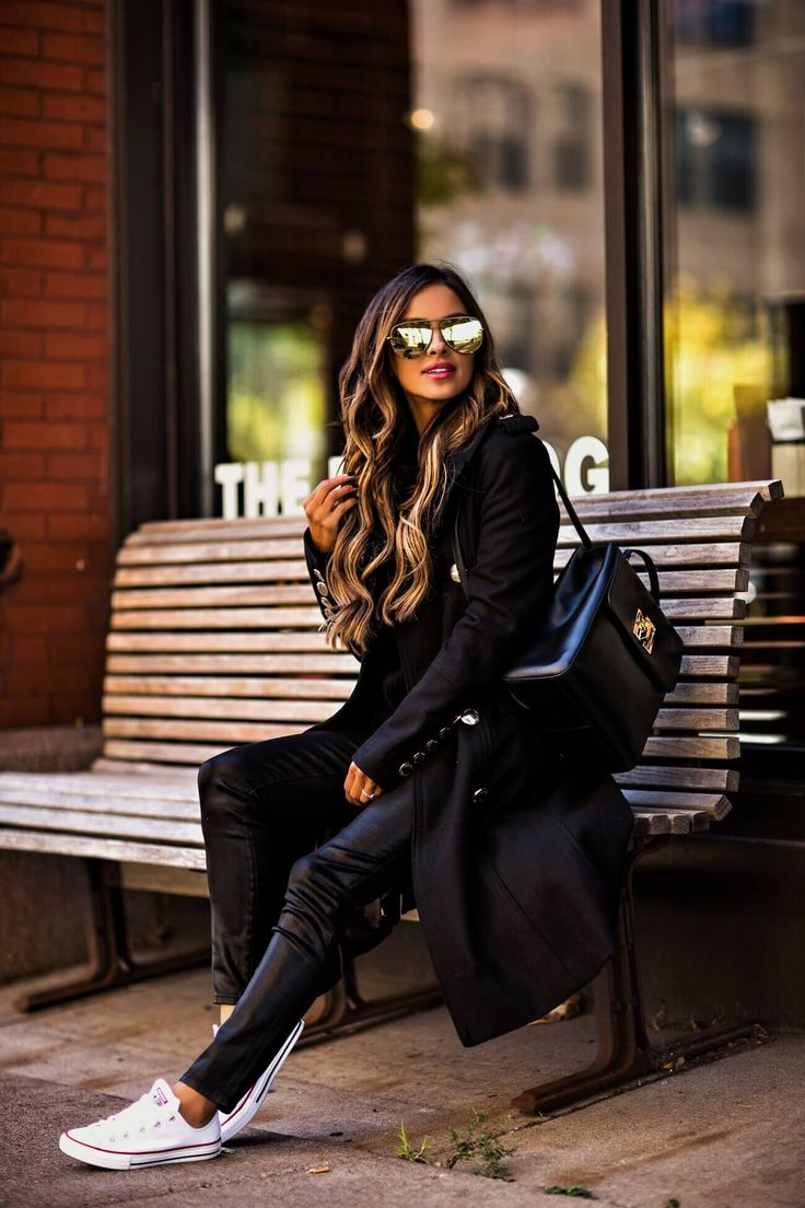 fashion blogger mia mia mine wearing a black coat from macy's and converse sneakers