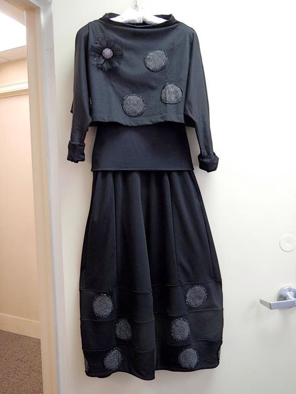 Love the funnel neck and the lantern shape of this skirt