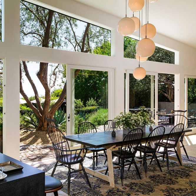 Dining room in this Frank Gehry-designed modern estate in Malibu, California that's owned by actor Patrick Dempsey. Credit: Brett Lawyer of Hilton & Hyland