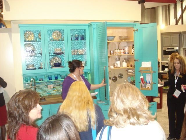 Karen's showing us her designs in the @Wellborn Cabinet Inc. booth. #kitchencabinetry #kitchendesign #cabinets #color