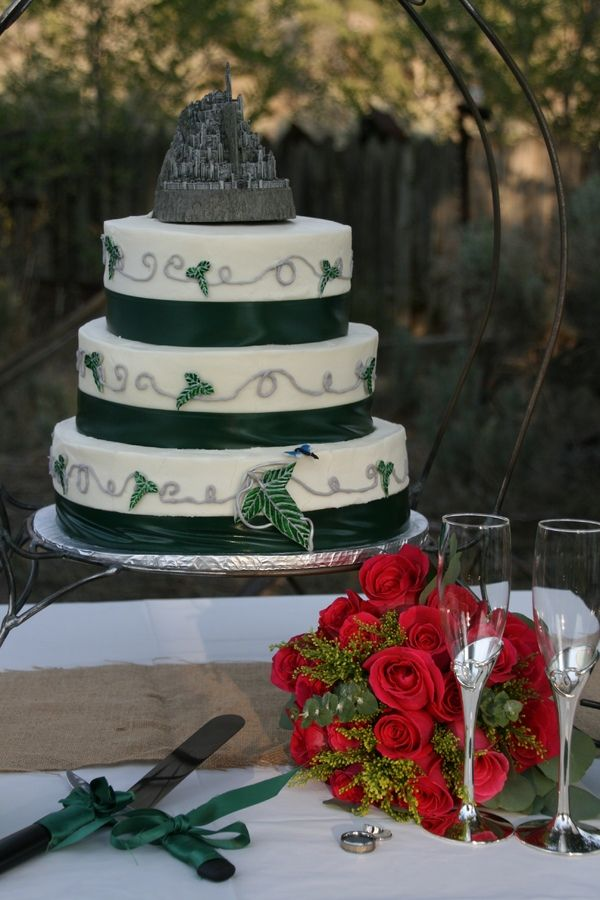 I made this cake for my wedding. We are huge Lord of the Rings fans. The Lothlorien leaf and dragonfly are fondant and the topper is a keeps...