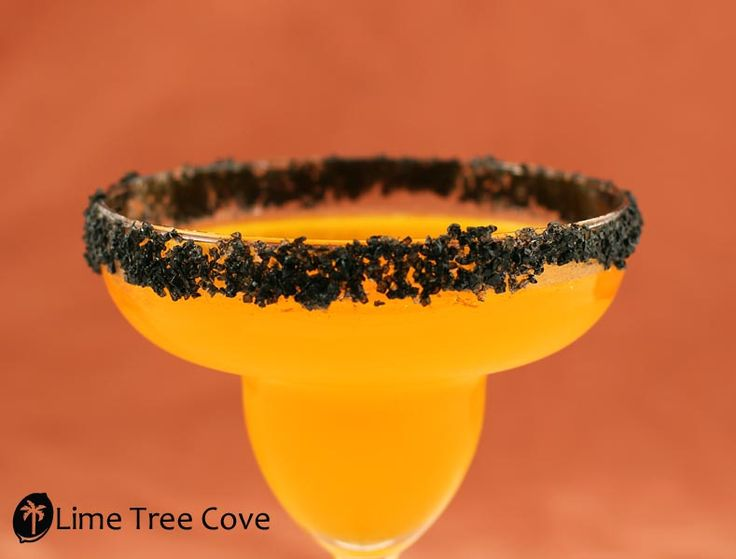Hallow-Rita - Halloween Margarita     4oz Newman's Own Limeade  2oz. Orange Juice  2oz Tequila  Splash Triple Sec  Fresh squeezed lime and lime slices  Ice  Natural Orange Colored Sugar from the Mischief Maker Package  Lime Tree Cove Hawaiian Black Lava Salt: Halloween Drinks, Holidays Halloween, Halloween Themed, Halloween Margaritas, Savory Recipe, Happy Holidays, Spooky Halloween, Orange Juice, Halloween Party