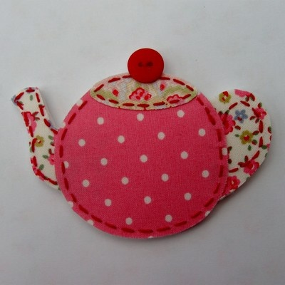 "Fridge Magnet ..TEAPOT Measuring 10cm approx in width at widest part and approx 7.5cm in depth. made with felt & Cath Kidston ""Mini Dot Pink, Paisley Pink and Tiny Rose"" fabric, hand-stitched detailing with a cute little button on the lid of the teapot"